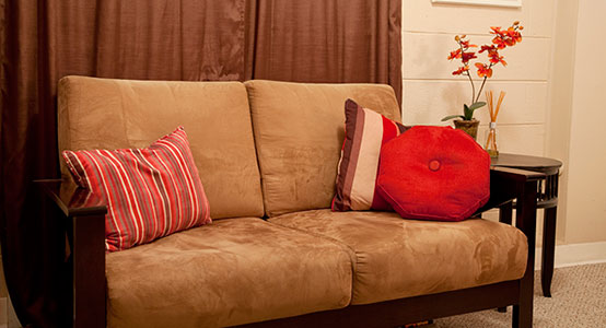 comfy brown couch with pillows
